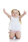 Beautiful blond little girl stands Royalty Free Stock Photography