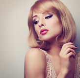Beautiful blond makeup woman with short hair style looking down. Stock Image