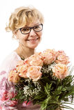Beautiful, blond mature woman with roses Stock Images