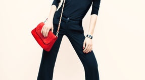 Beautiful blond model classic black style with red fashionable c Stock Photo