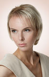 Beautiful blond model with freckles looking off camera Royalty Free Stock Image