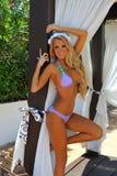Beautiful blond model posing outside Royalty Free Stock Photography