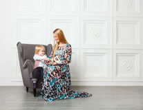 Beautiful blond mother with little daughter Royalty Free Stock Image