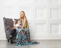 Beautiful blond mother with little daughter Royalty Free Stock Photos
