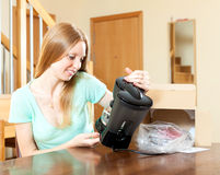 Beautiful blond with new electric coffee maker at home Stock Photos