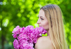 Beautiful blond with peony flowers Stock Photo