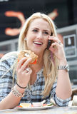 Beautiful blond on the phone stock photography