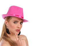 Beautiful blond with pink hat in thoughtful reflection with cop. Yspace to the right - isolated on white background. Head shot of attractive female Royalty Free Stock Images