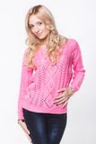 Beautiful blond in a pink sweater Royalty Free Stock Photo