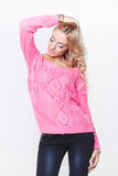 Beautiful blond in a pink sweater Royalty Free Stock Photos