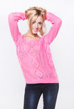 Beautiful blond in a pink sweater Royalty Free Stock Images