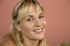 Beautiful blond portrait head only she is smiling and happy Stock Photography