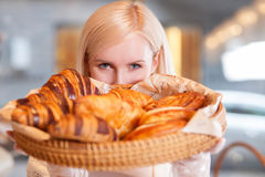 Beautiful blond saleswoman is working at bakery Royalty Free Stock Photos