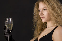 Beautiful blond sexy girl drinking champagne. Royalty Free Stock Photography