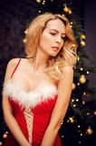 Beautiful blond sexy woman in red christmas dress Stock Photo