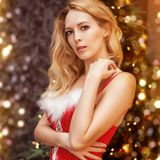 Beautiful blond woman in red christmas dress stock photos
