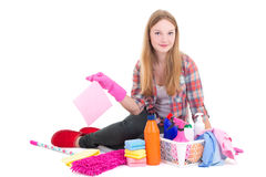 Beautiful blond sitting with cleaning equipment isolated on whit Royalty Free Stock Image