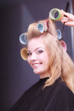 Beautiful blond smiling girl hair curlers rollers hairdresser beauty salon Royalty Free Stock Photography