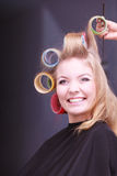 Beautiful blond smiling girl hair curlers rollers hairdresser beauty salon Stock Images