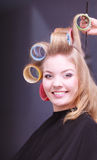 Beautiful blond smiling girl hair curlers rollers hairdresser beauty salon Stock Photos