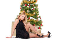 Beautiful blond smiling woman and the Christmas tree Stock Photo