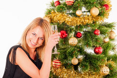Beautiful blond smiling woman and Christmas tree Stock Images
