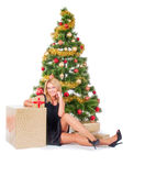 Beautiful blond smiling woman and Christmas tree Stock Photography