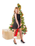 Beautiful blond smiling woman and Christmas tree Royalty Free Stock Photos