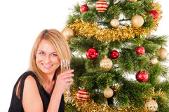 Beautiful blond smiling woman and Christmas tree Royalty Free Stock Photography