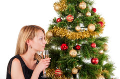 Beautiful blond smiling woman and Christmas tree Royalty Free Stock Photo