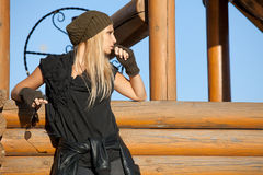 Beautiful blond standing near wooden well Stock Images