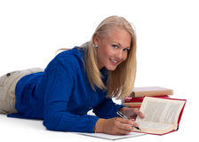 Beautiful blond student doing her homework Royalty Free Stock Images