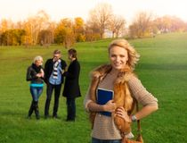 Beautiful blond student with friends Stock Photo