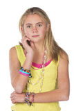 Beautiful blond teen. Age girl in studio with isolated photos Stock Photos