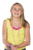 Beautiful blond teen. Age girl in studio with isolated photos Royalty Free Stock Photo