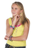 Beautiful blond teen. Age girl in studio with isolated photos Stock Image