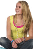 Beautiful blond teen. Age girl in studio with isolated photos Royalty Free Stock Image