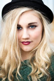 Beautiful Blond Teenage Girl in a Bowler Hat Royalty Free Stock Photo