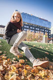 Beautiful blond teenage girl in glasses in park Stock Photos