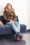 Beautiful blond teenage girl in warm clothes Royalty Free Stock Photo