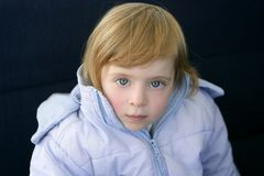 Beautiful blond toddler little girl  winter coat. Beautiful blond toddler little girl with blue winter coat Stock Image