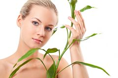 Beautiful blond touches bamboo Royalty Free Stock Photo