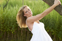 Beautiful Blond Under Tree Royalty Free Stock Photos