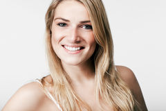 Beautiful blond with a vivacious smile Stock Image