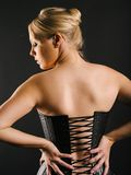 Beautiful blond wearing leather corset Stock Images