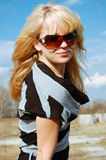 Beautiful blond woman. Portrait of blond young woman outdoor Royalty Free Stock Photography
