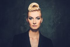 Beautiful blond woman. Fashionable woman with creative hairstyle Royalty Free Stock Image