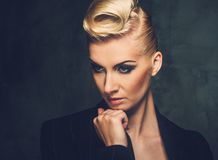 Beautiful blond woman. Fashionable woman with creative hairstyle Stock Photo