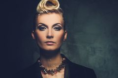 Beautiful blond woman. Fashionable woman with creative hairstyle Royalty Free Stock Photo