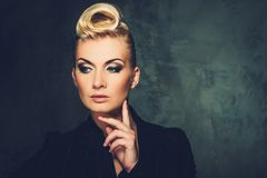 Beautiful blond woman. Fashionable woman with creative hairstyle Royalty Free Stock Photography